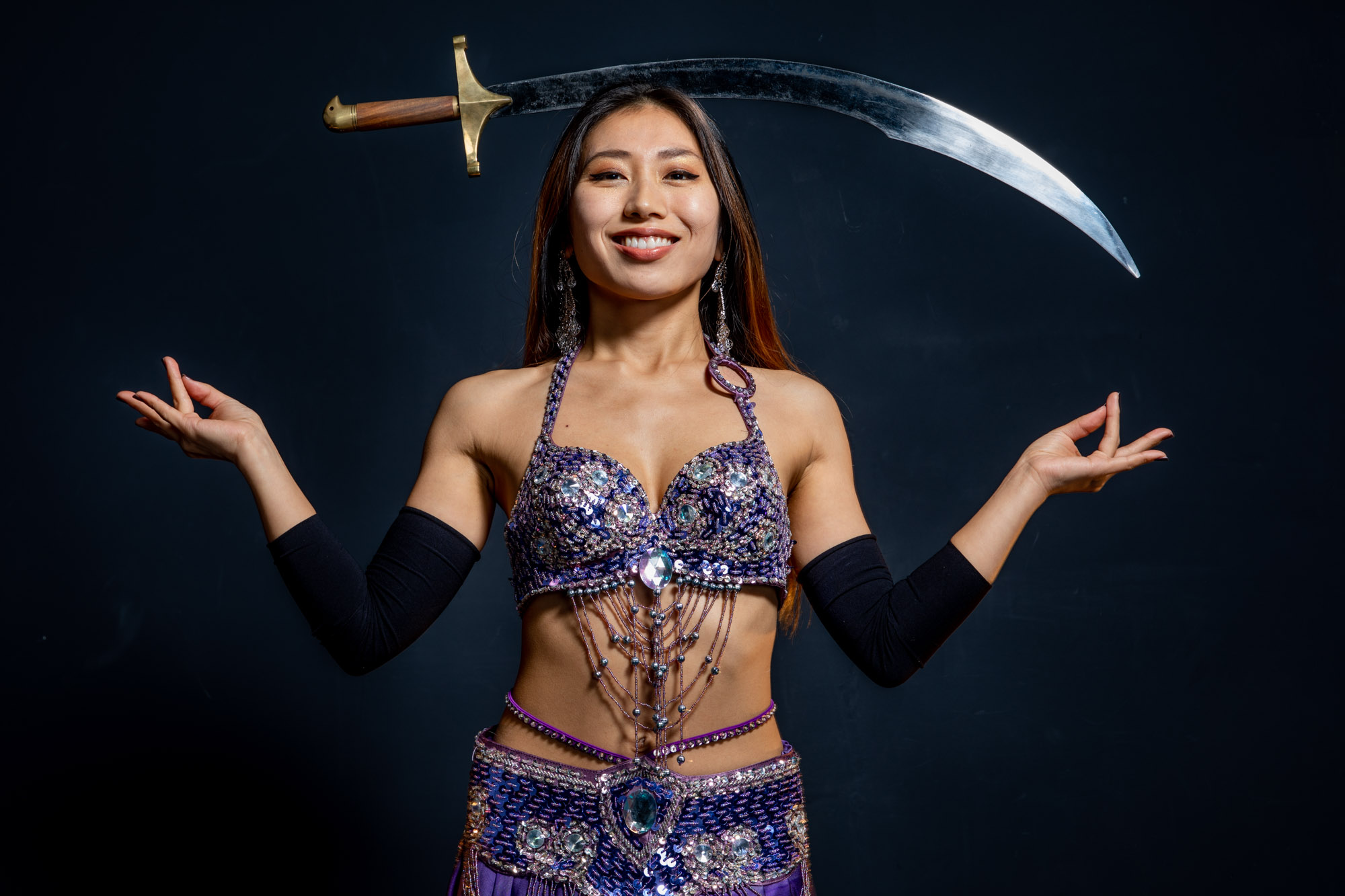 a belly dancer posing with her sword